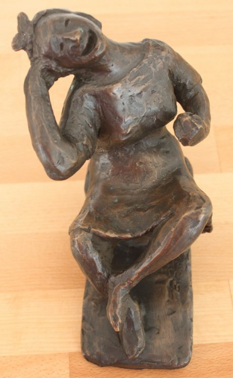 Bronze Figure: Seated Girl Laughing.