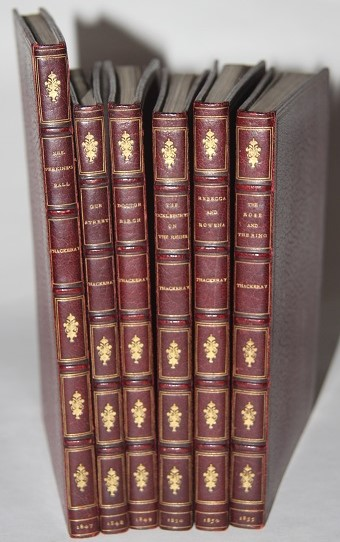 Set of the Six Christmas Books or Satiric Novellas Thackeray Both Wrote and Illustrated using the pseudonym T. A. Titmarsh including Mrs. Perkins Ball 1847 Our Street 1848 Doctor Birch 1849 Rebecca and Rowena 1850 The Kickleburys on the Rhine 1850 and The Rose and the Ring 1855