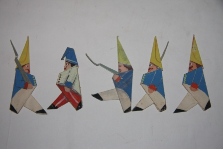 Charming group of hand-made and painted folk art origami figures including fourteen soldiers three horses a flag on a staff and two incomplete figures a horse and a soldier